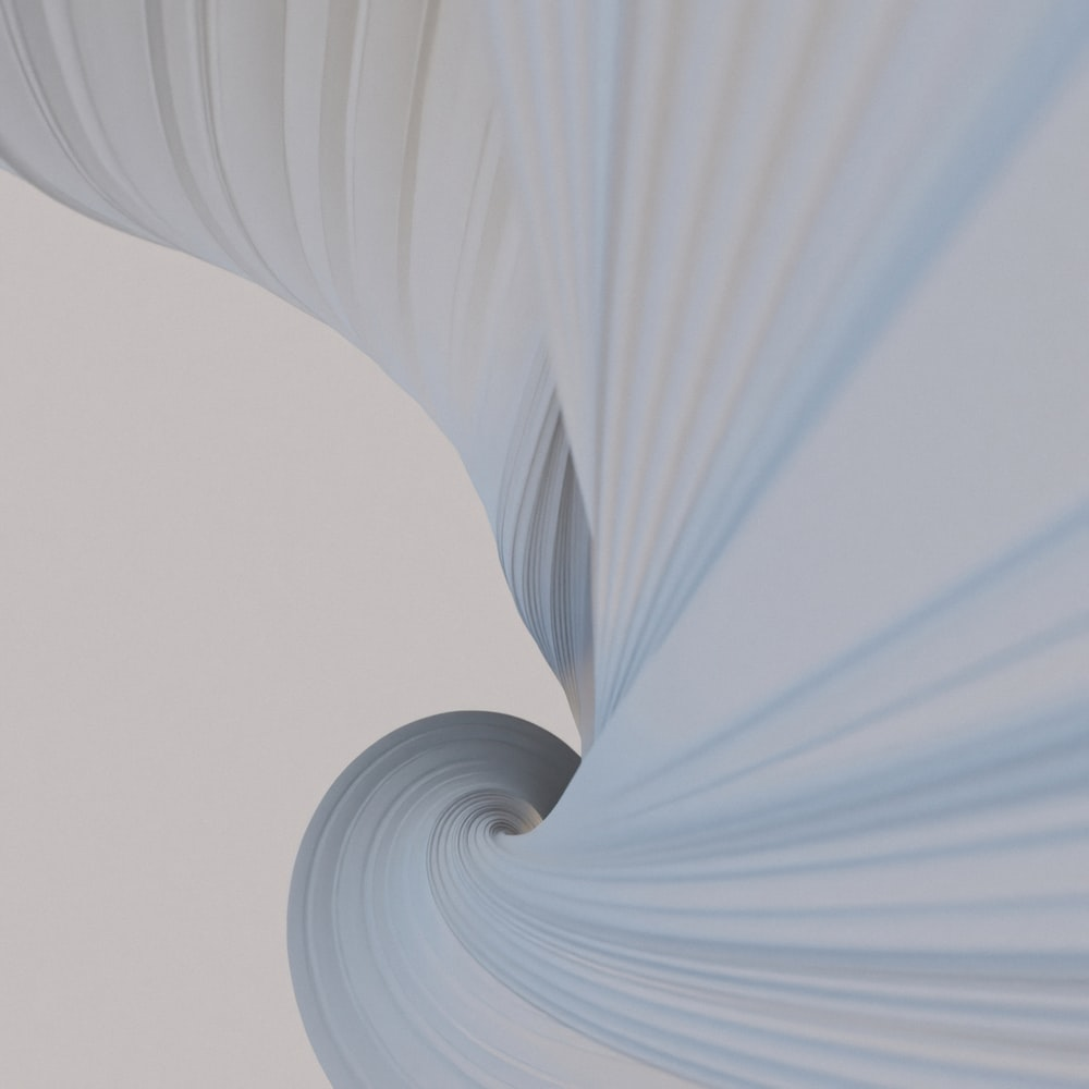 white and blue spiral textile