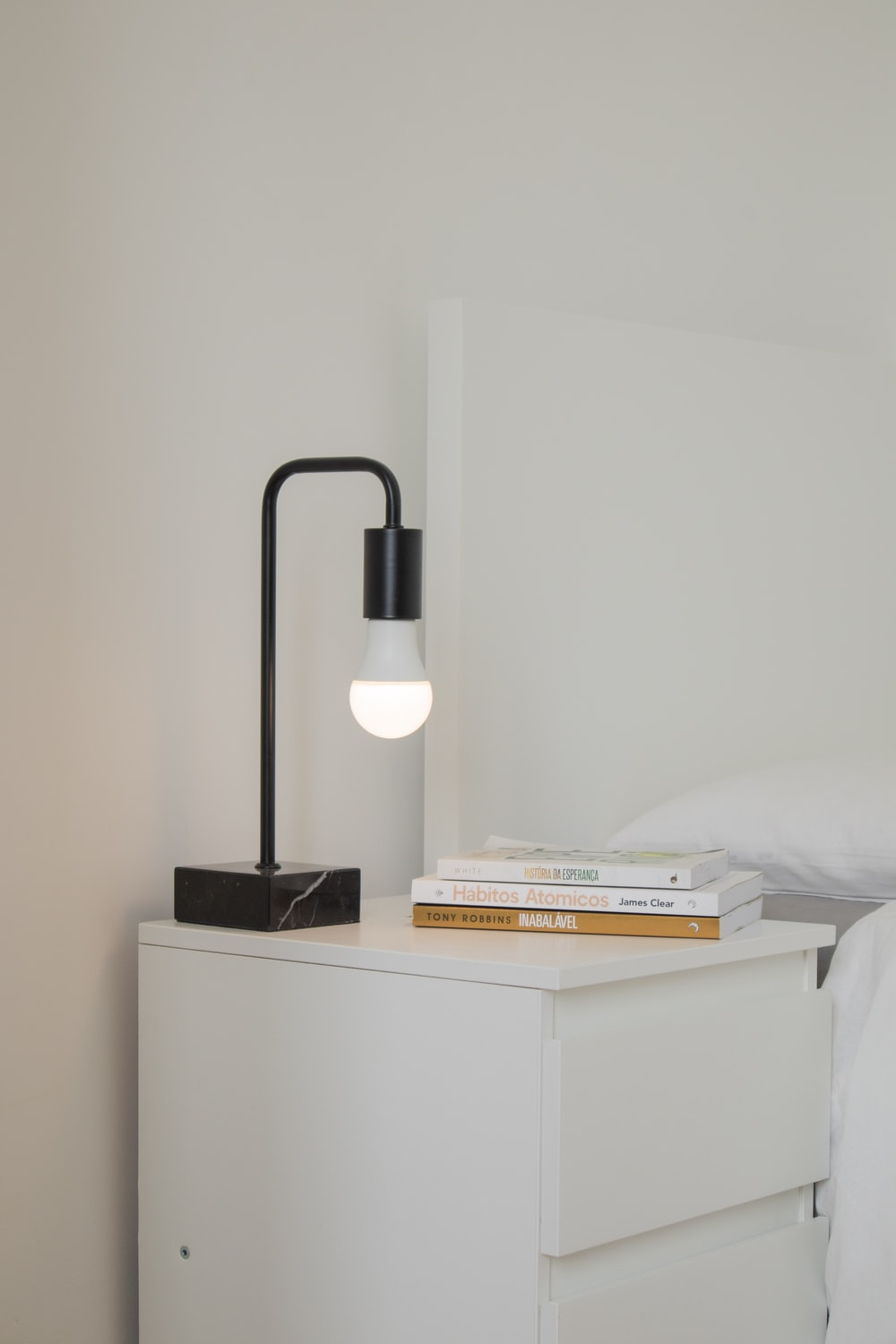 white and black desk lamp on white wooden table