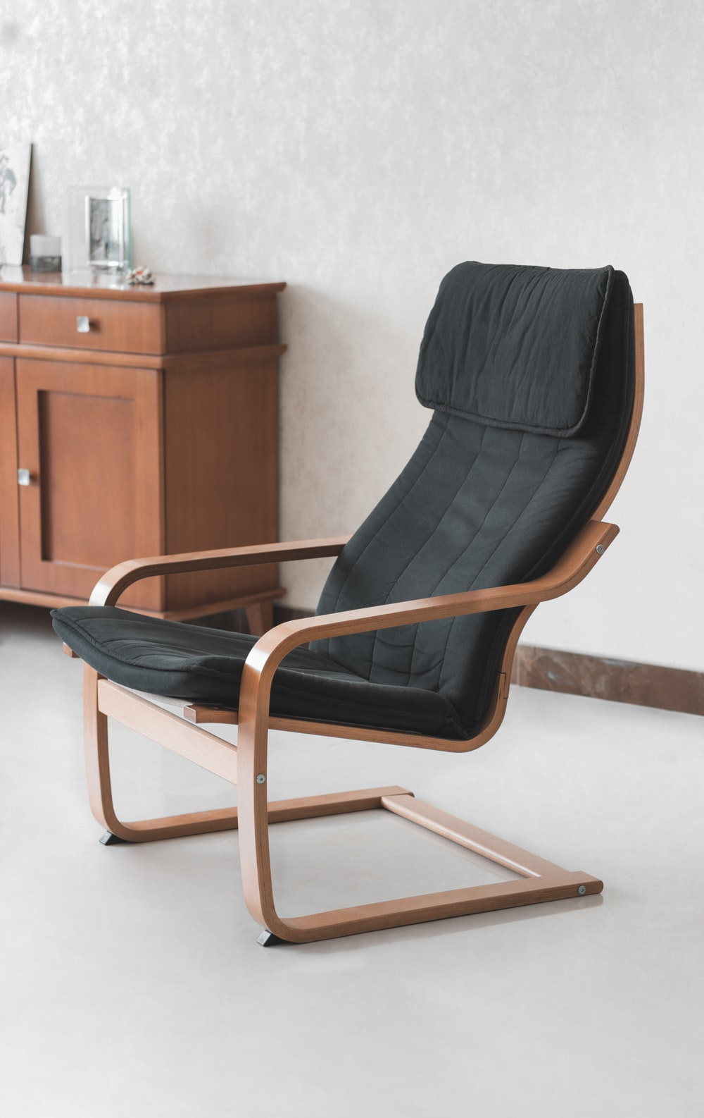 black padded brown wooden armchair