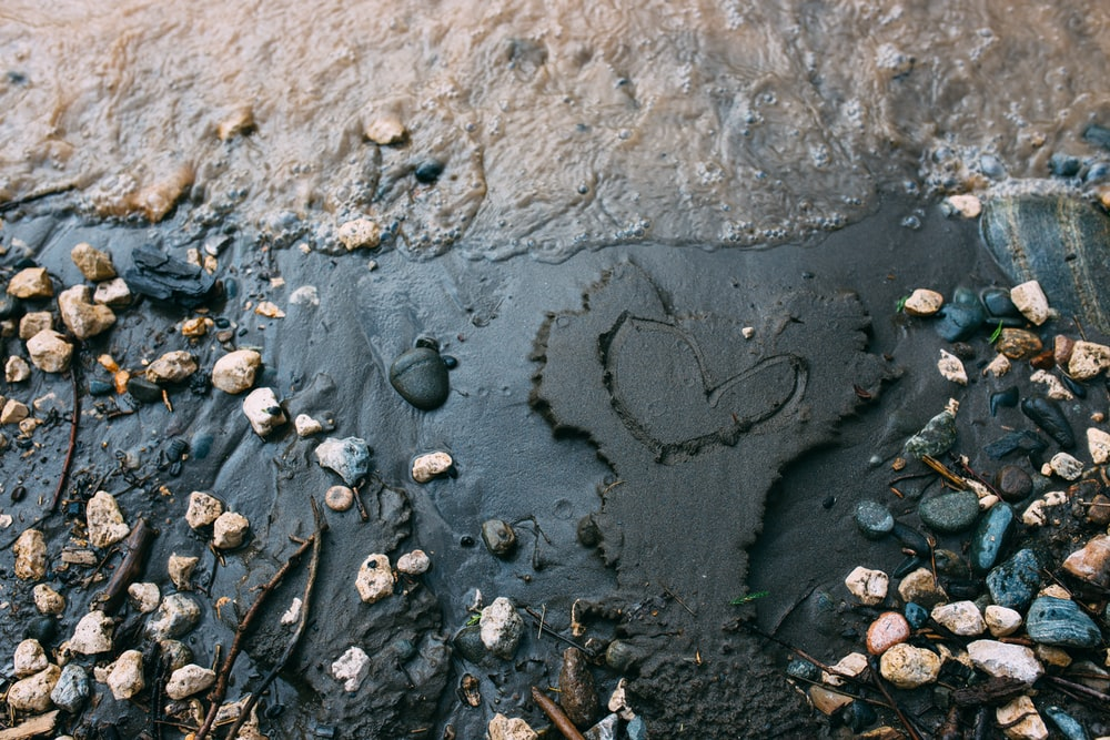 water droplets on gray concrete surface
