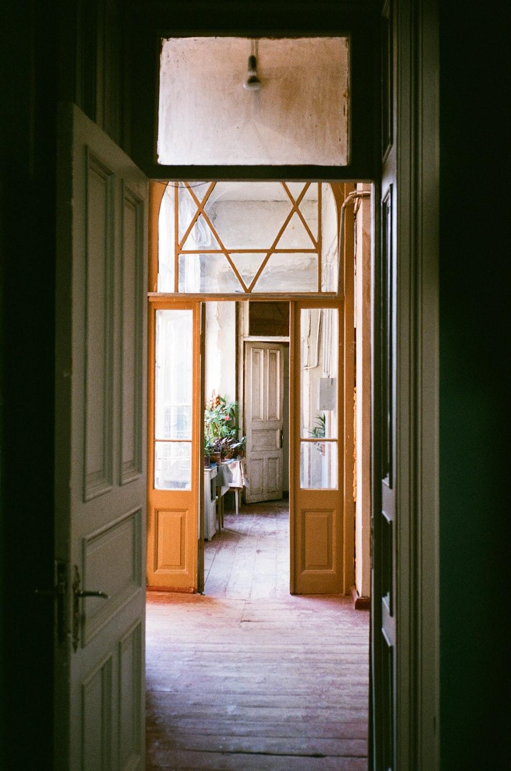 brown wooden door with glass panel