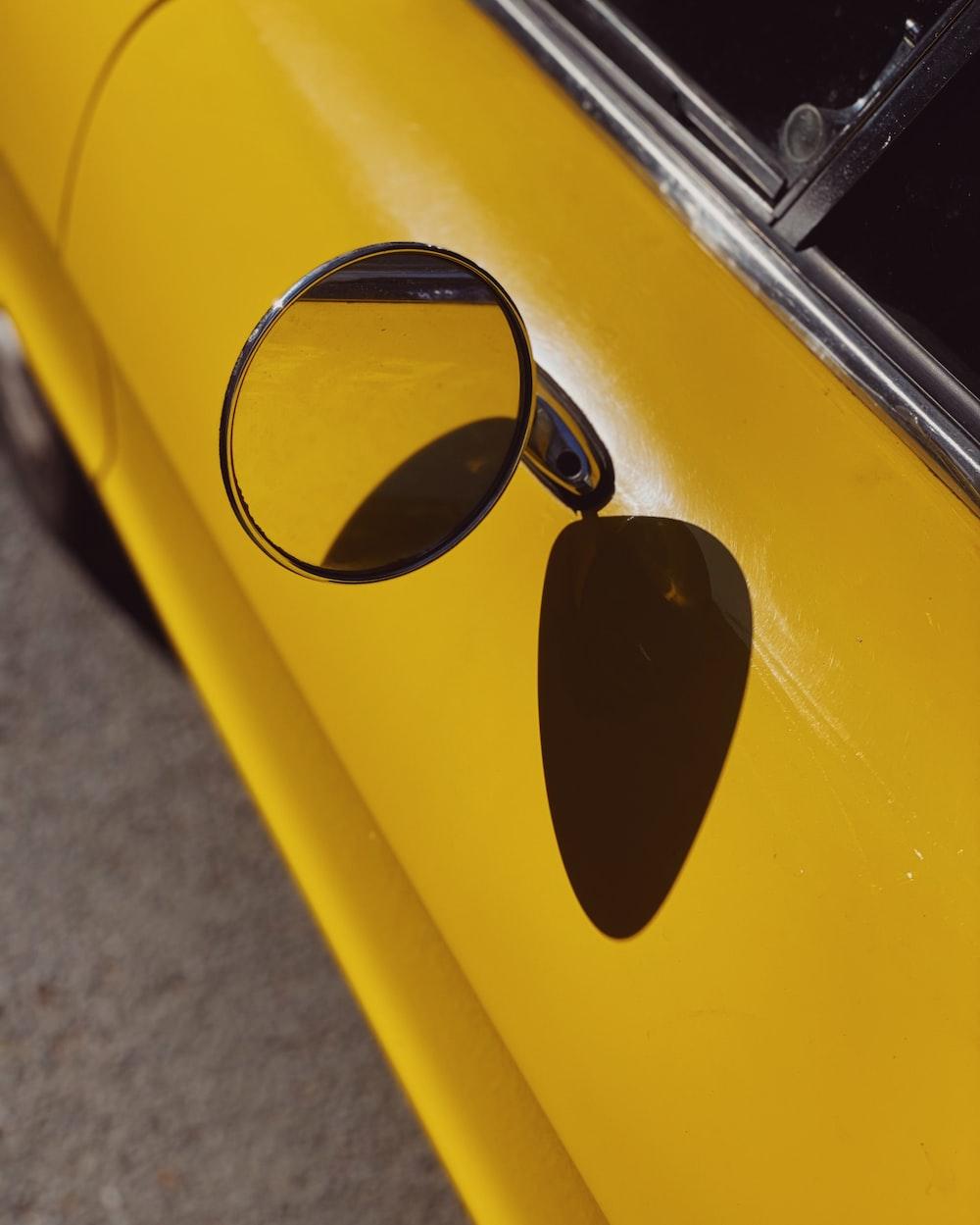 black sunglasses on yellow car