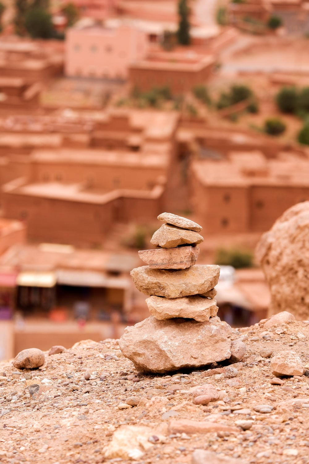 stack of stones on brown sand during daytime