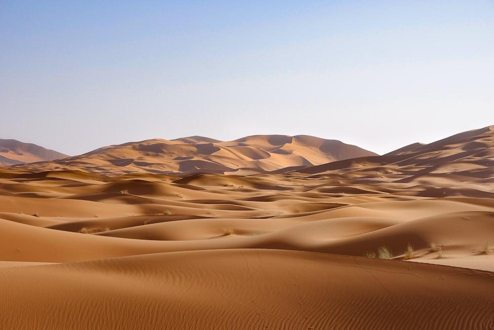 brown desert under blue sky during daytime