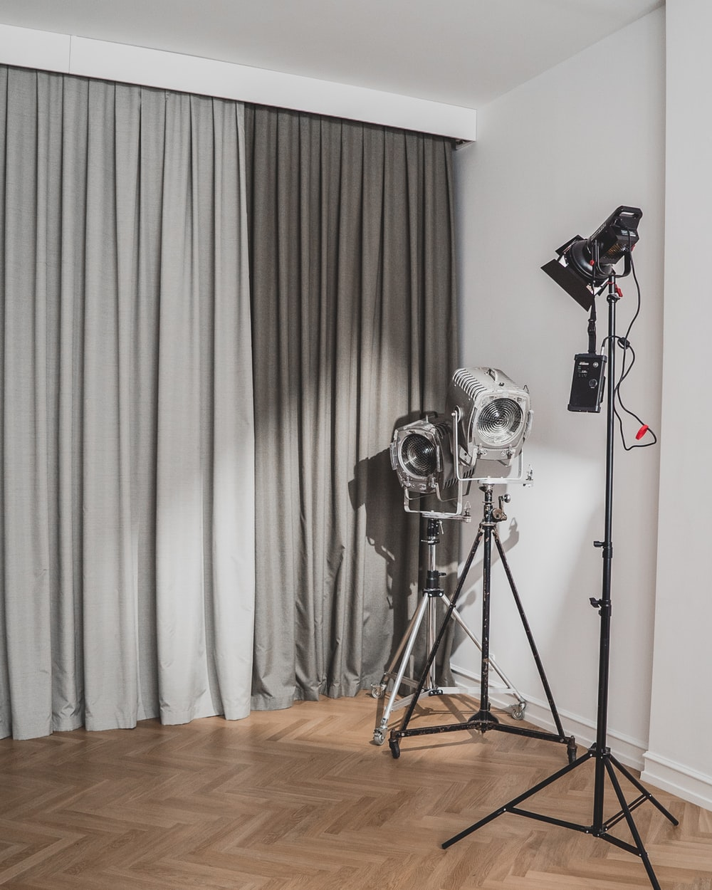 black and silver camera on tripod
