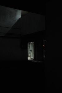white wooden door in gray concrete building