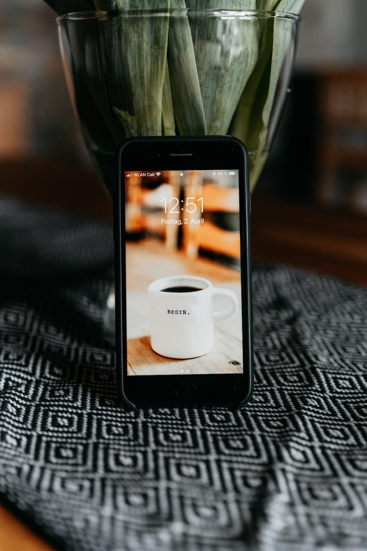 white ceramic mug on black wooden tray