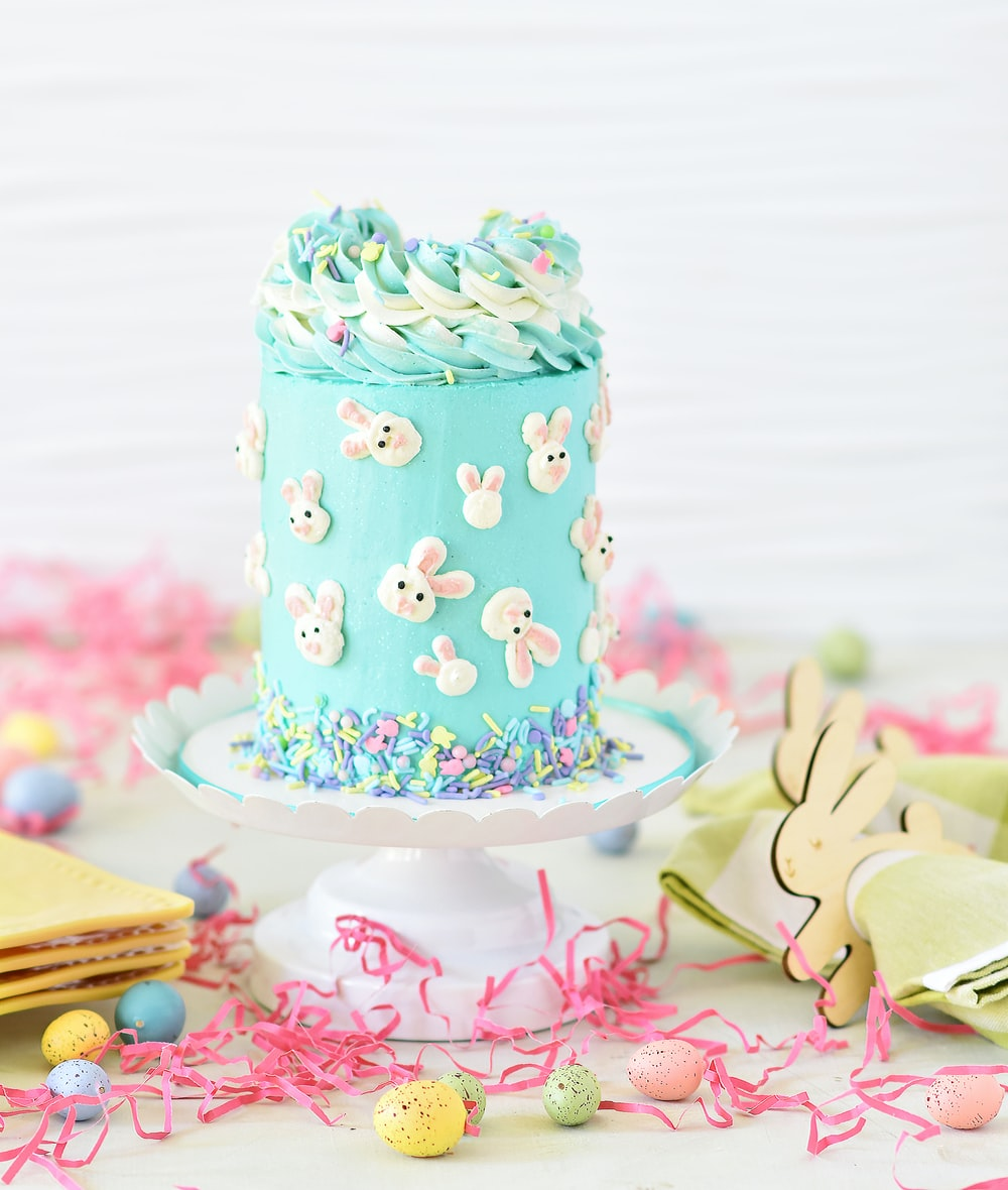 blue and white polka dot cake on pink and white heart shaped cake stand