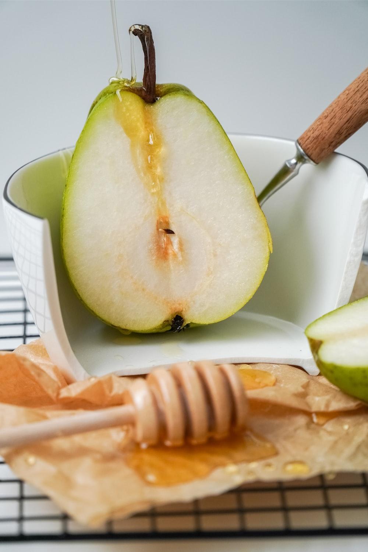 sliced green fruit on white ceramic plate