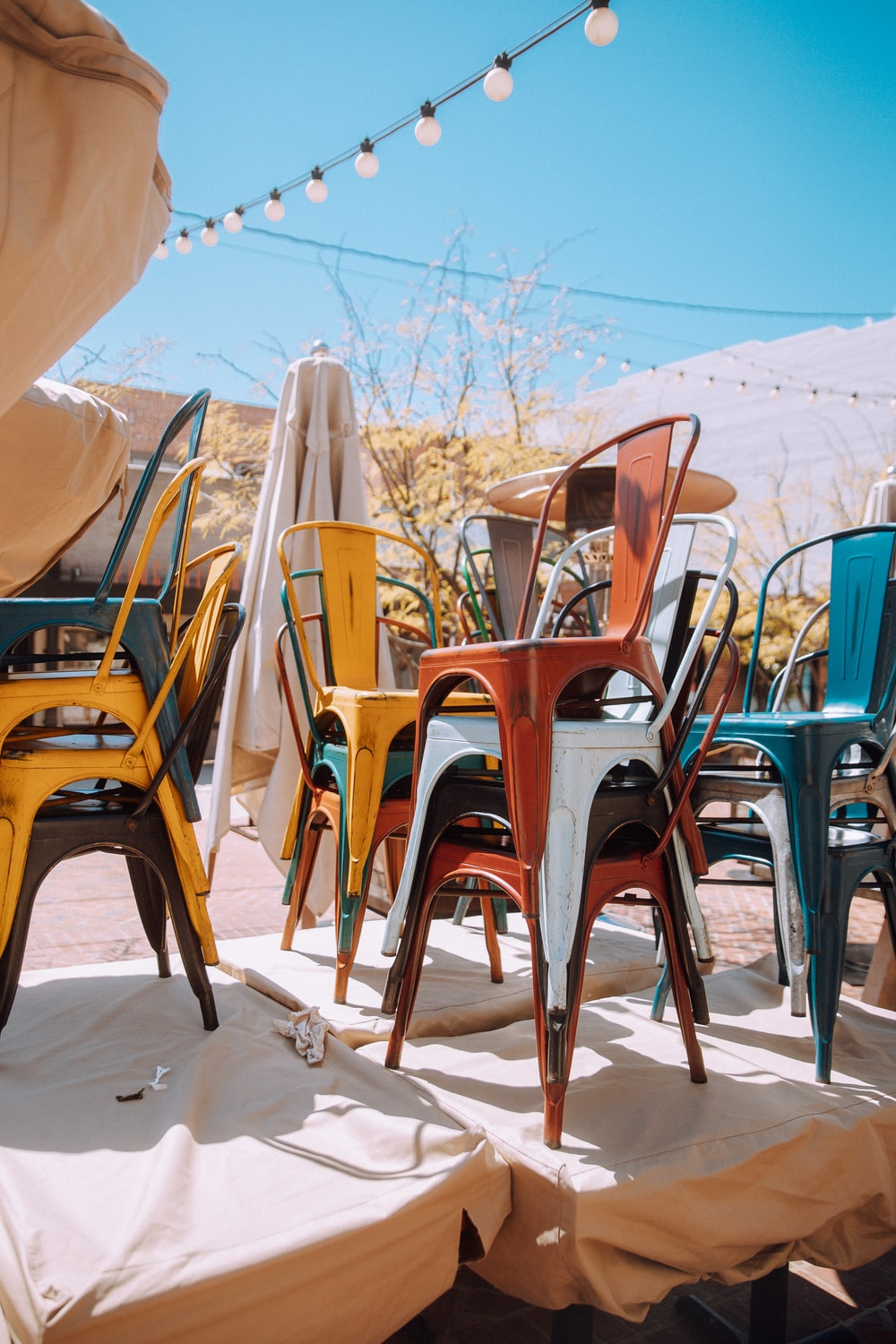 brown wooden chairs on white sand during daytime