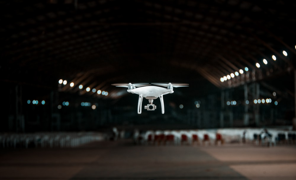 white drone in a building