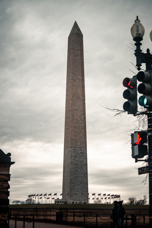 gray concrete tower under gray sky