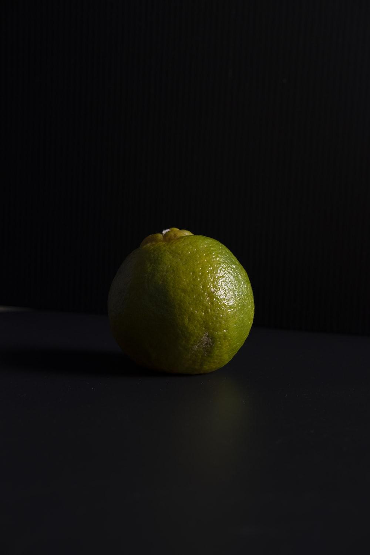 yellow lemon fruit on black surface