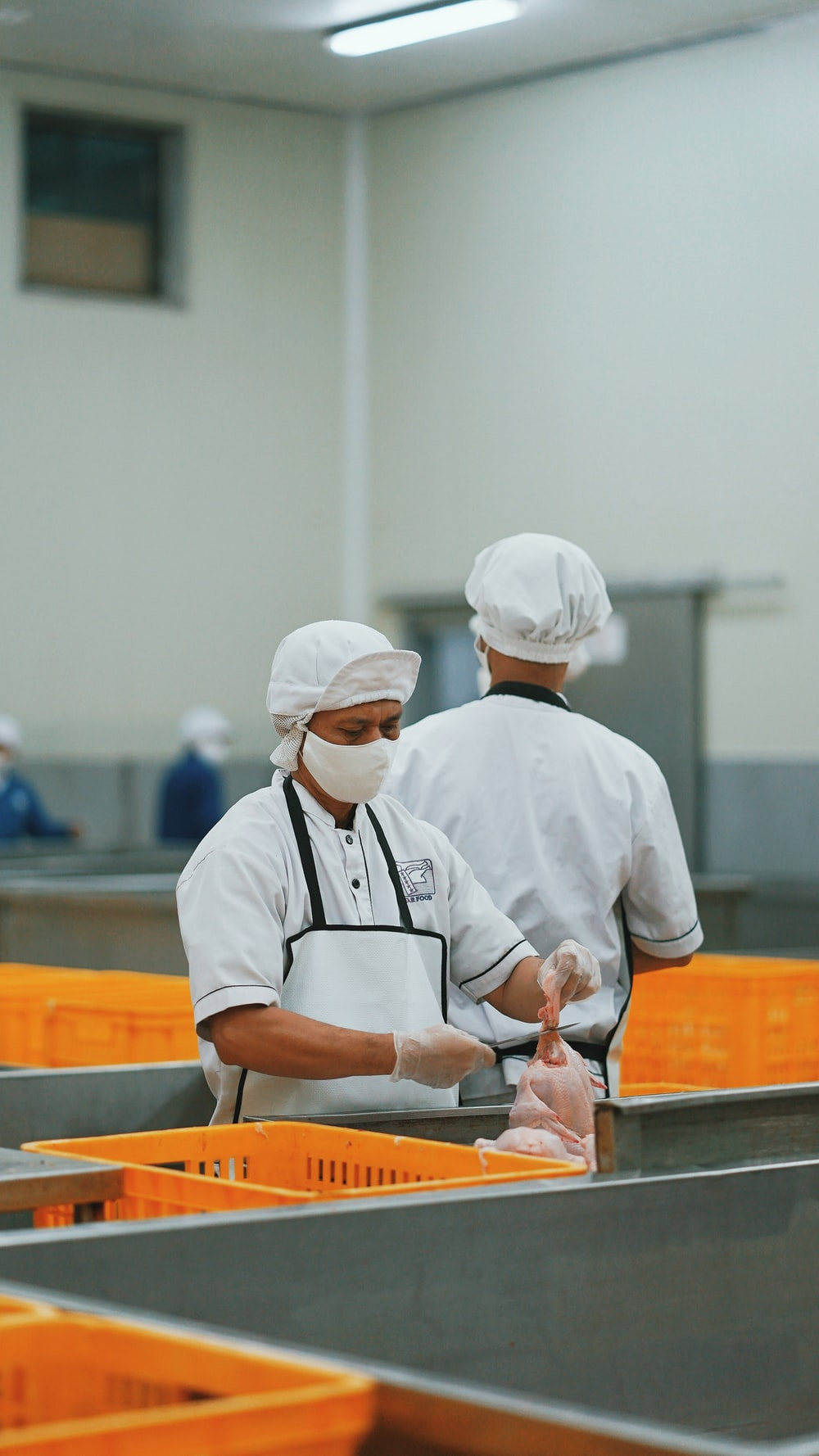man in white chef uniform holding knife