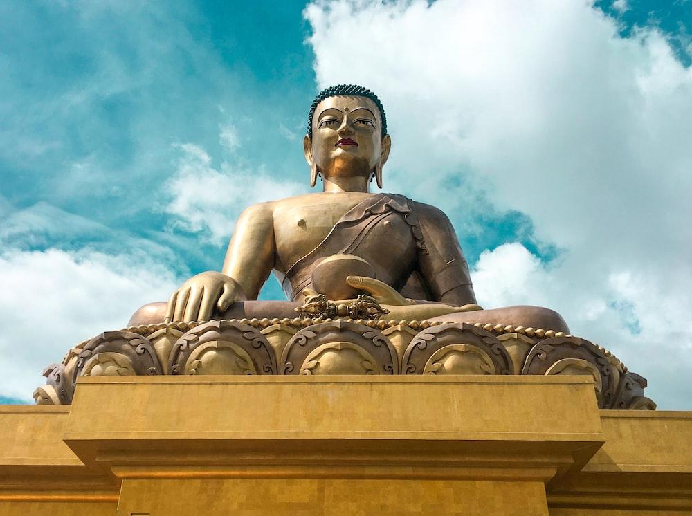 gold statue under blue sky during daytime