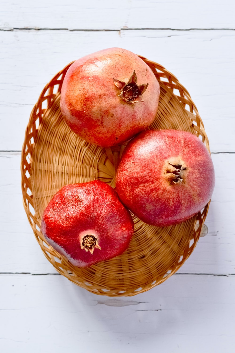 red apples on brown woven basket