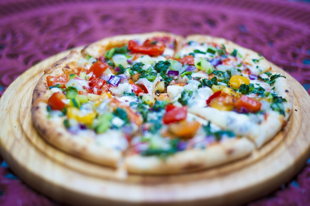 pizza with green and red bell pepper and cheese