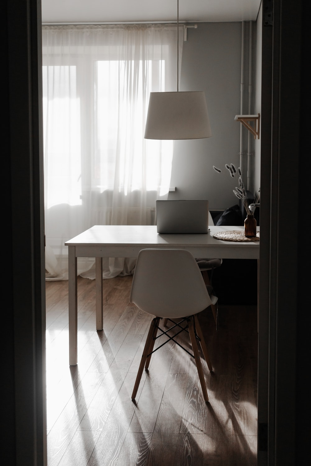 white table lamp on white table