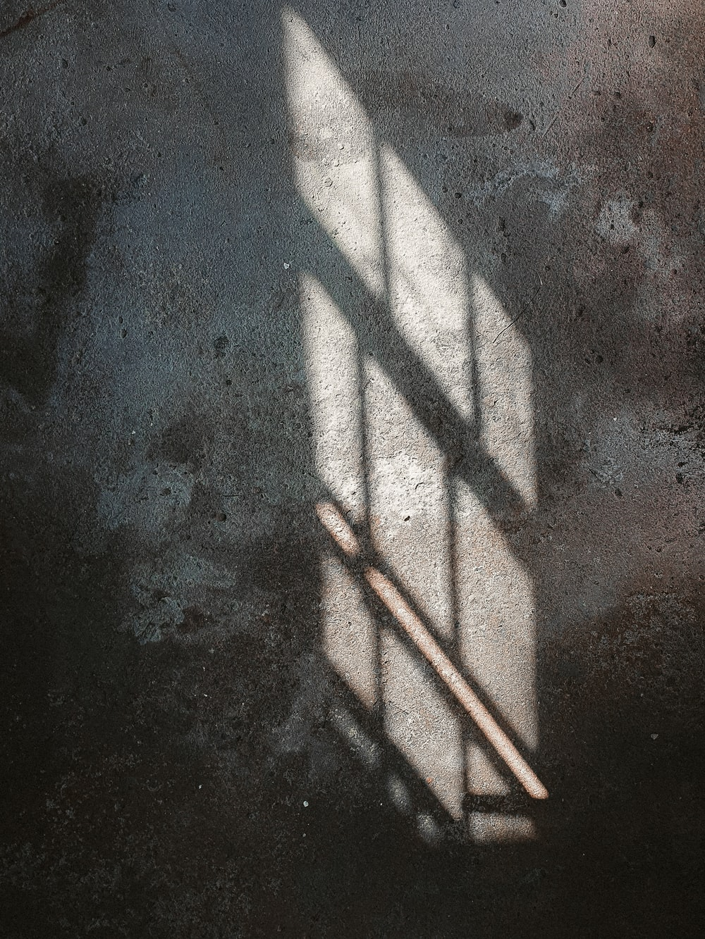 white metal fence on gray concrete floor