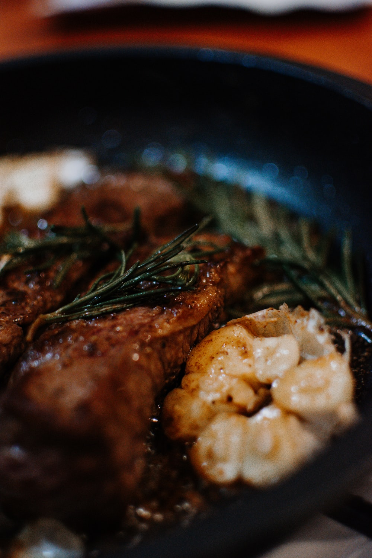 cooked food on black ceramic bowl