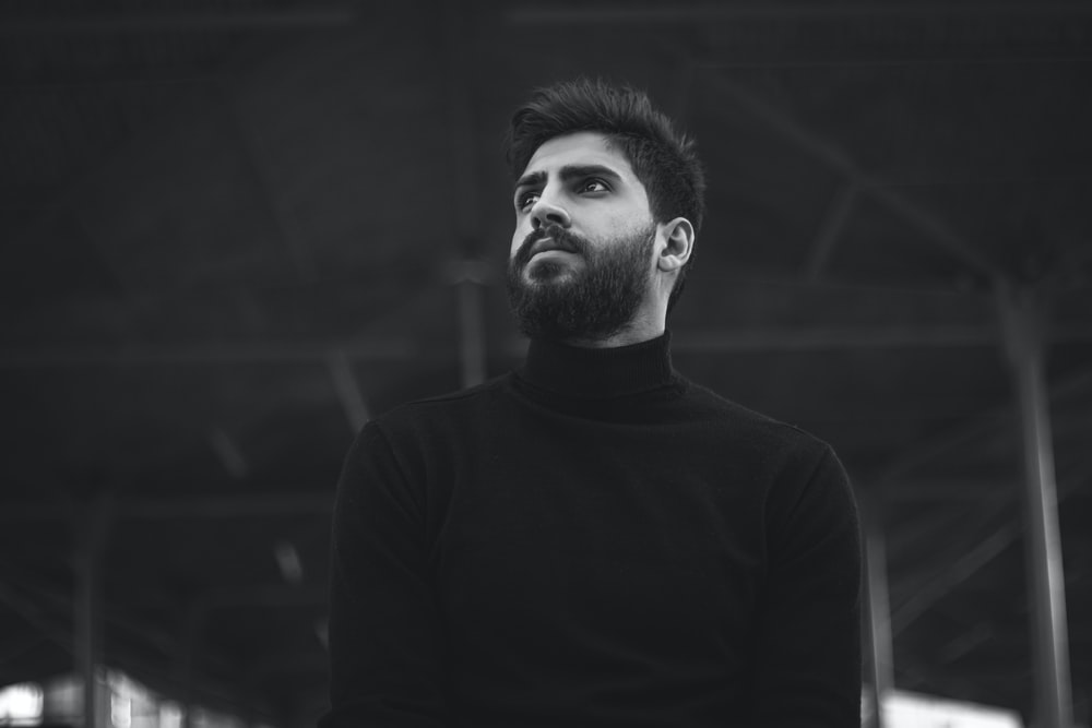 man in black turtleneck sweater