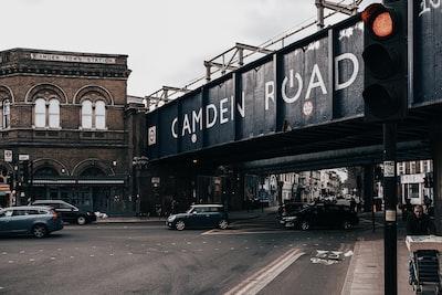 London black car parked beside black car during daytime