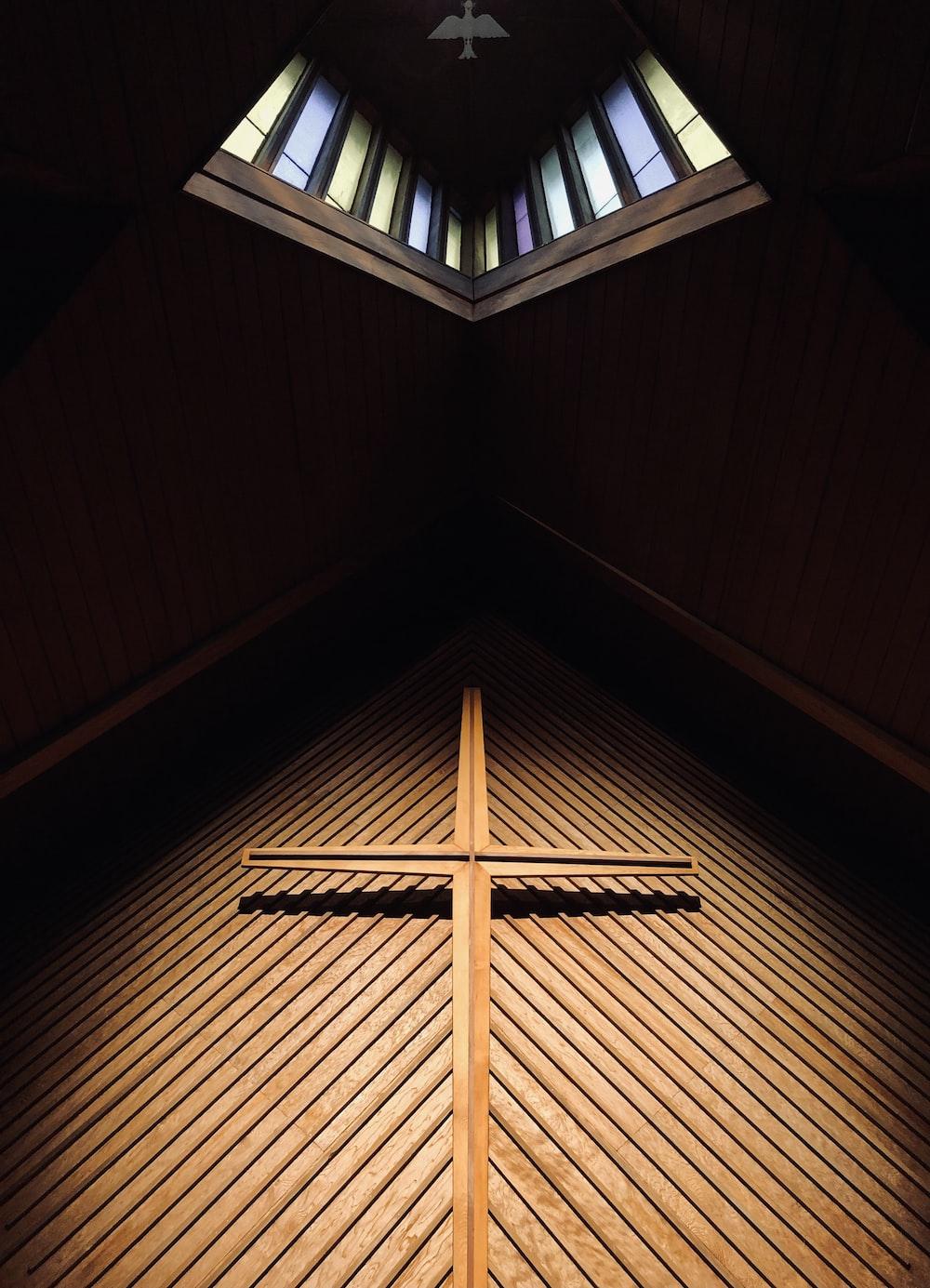 brown wooden cross on brown wooden ceiling