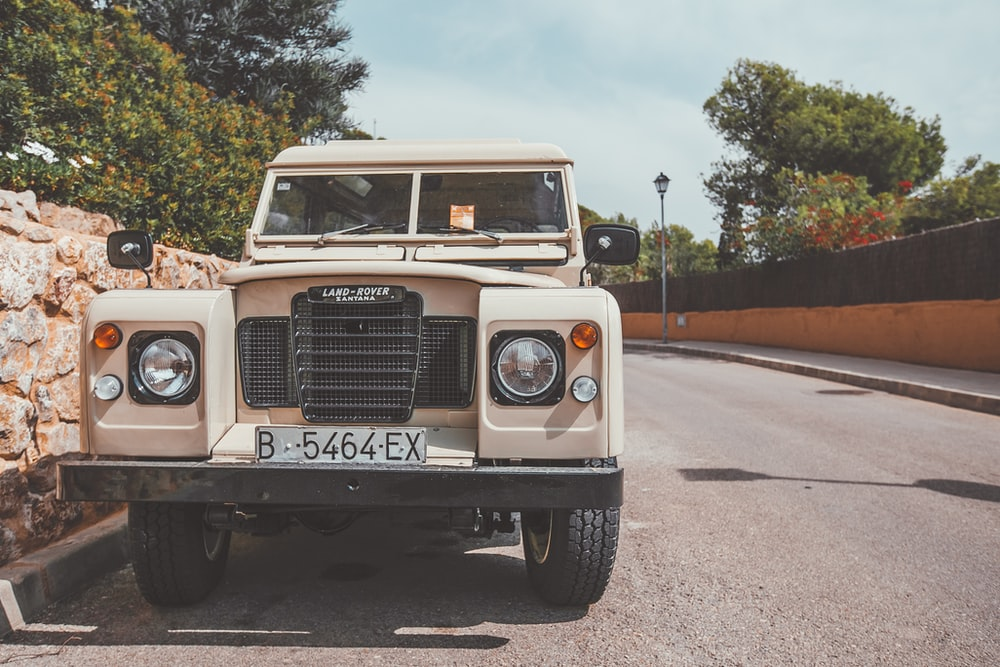 white jeep wrangler on road during daytime