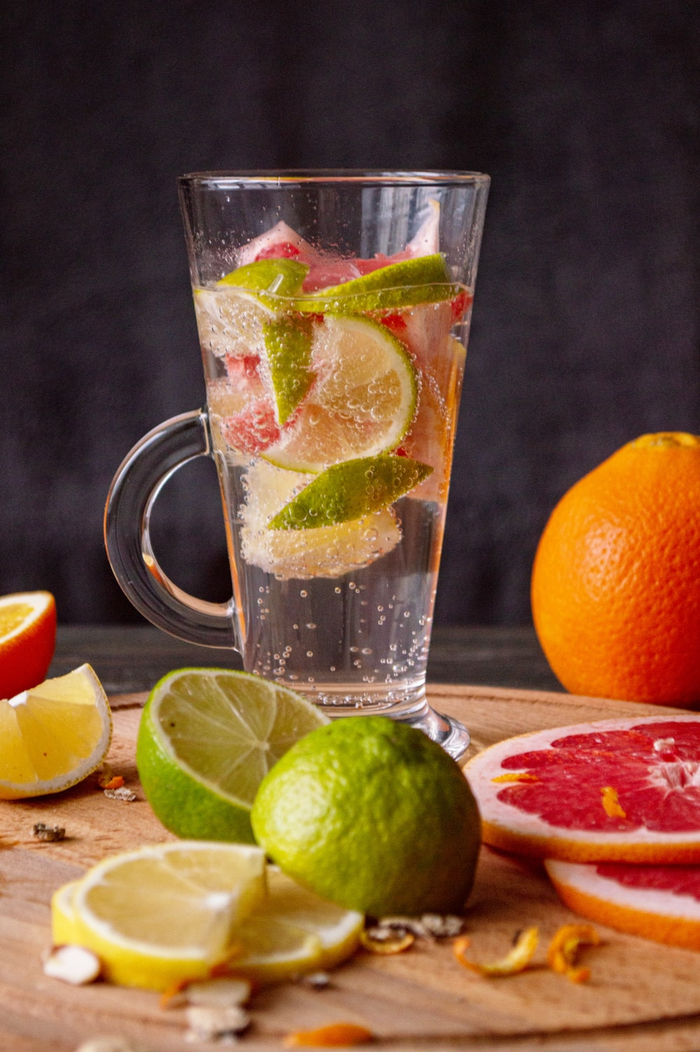 clear glass mug with sliced orange fruit and water