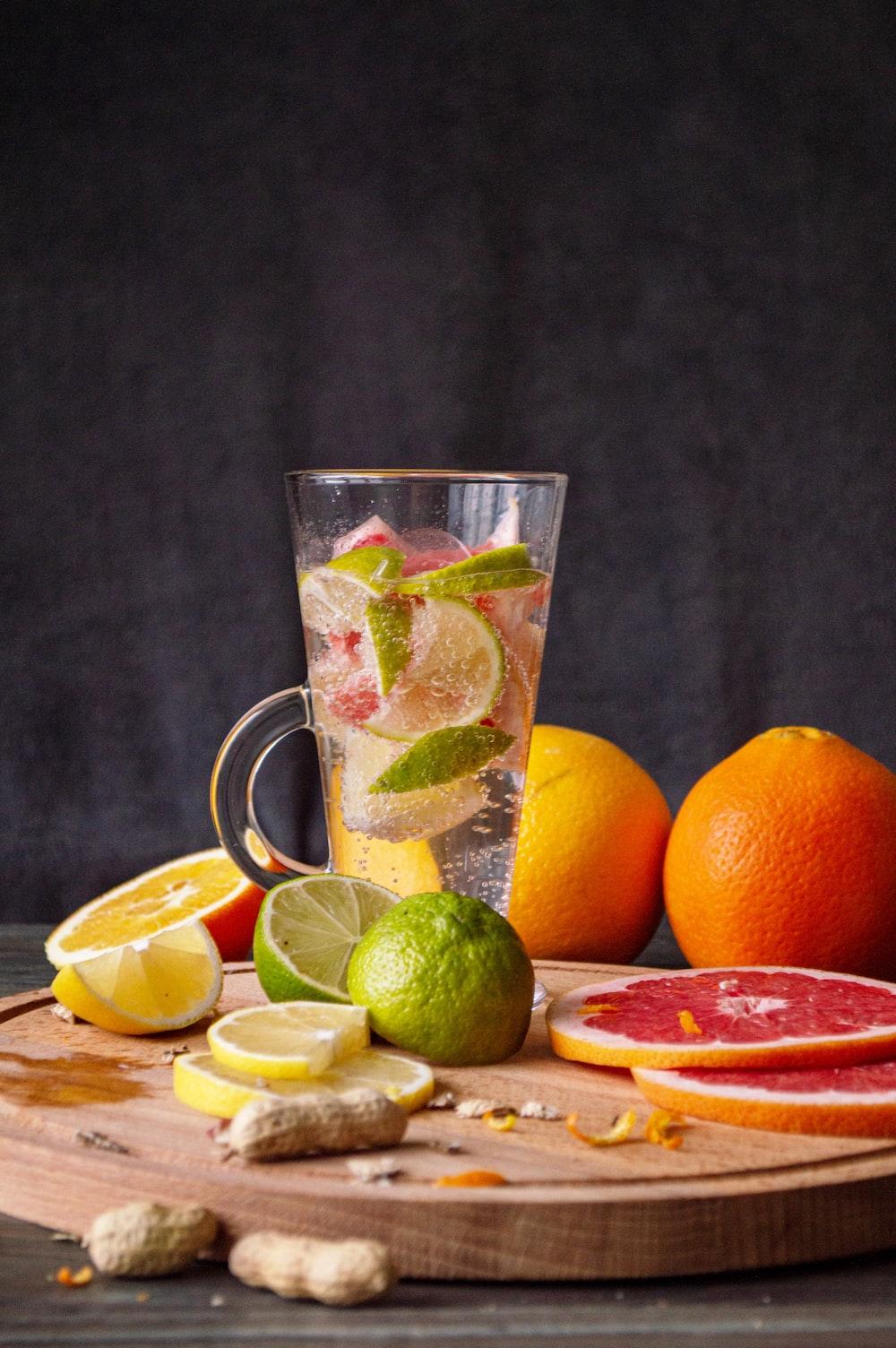 clear glass mug with orange fruits