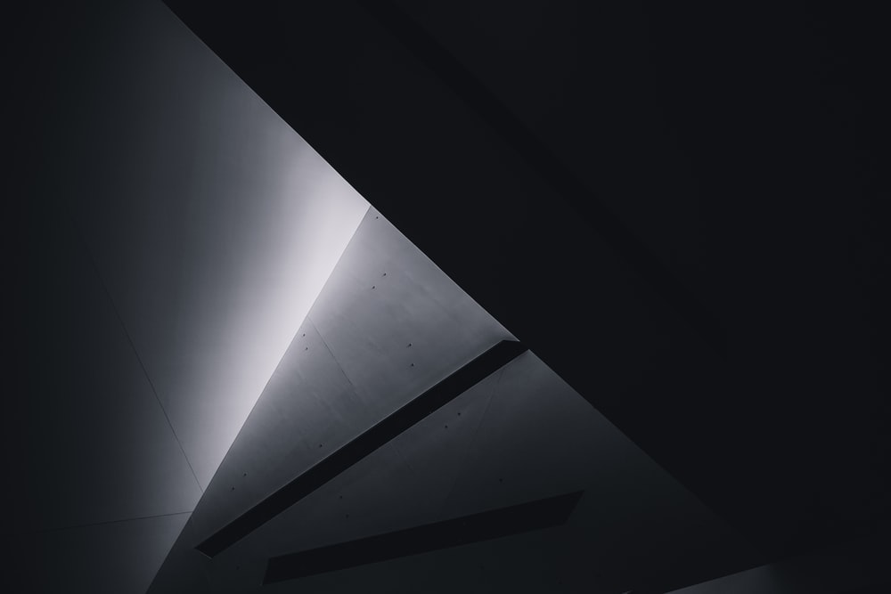 grayscale photo of a tunnel