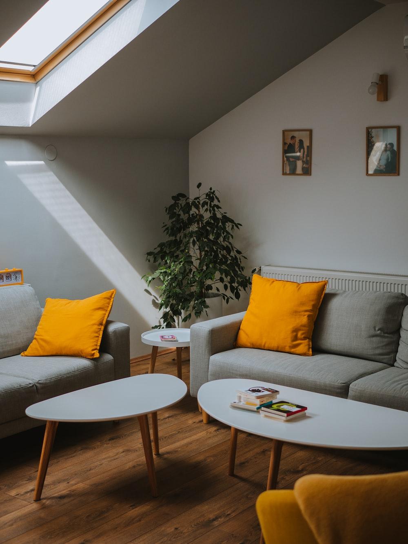 white wooden framed gray padded armchair
