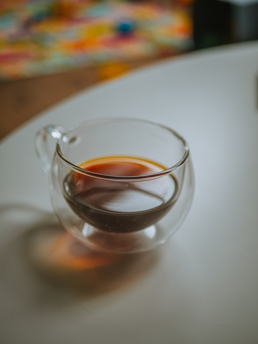 clear glass teacup on white table