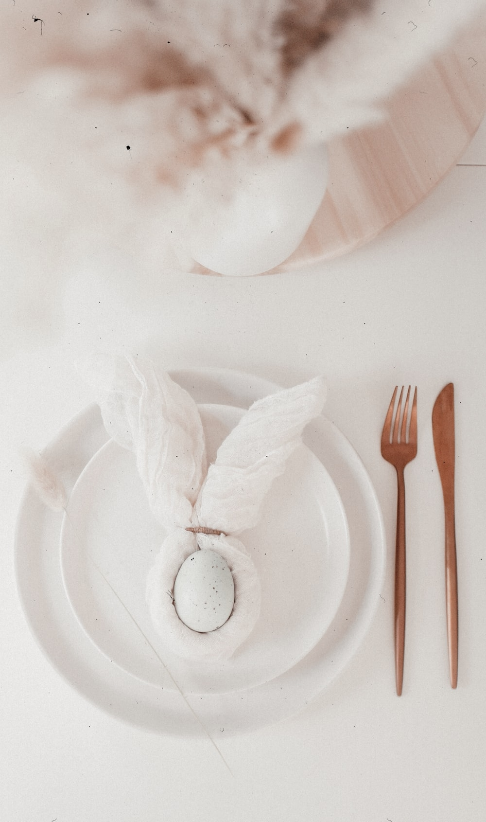 white ceramic plate with fork and knife