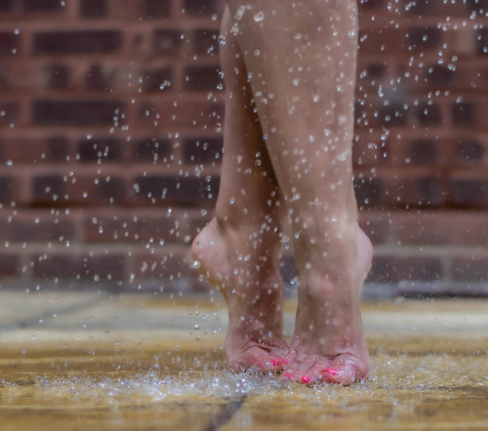 person standing on wet ground