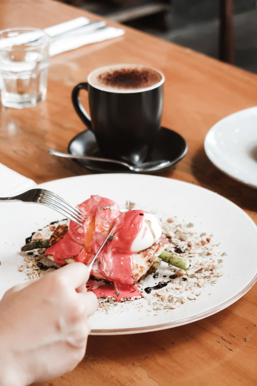 sliced strawberry on white ceramic plate