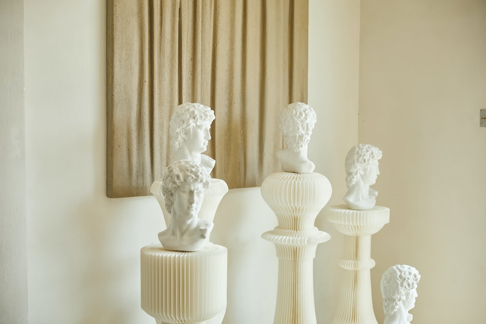 white ceramic angel figurine on white table
