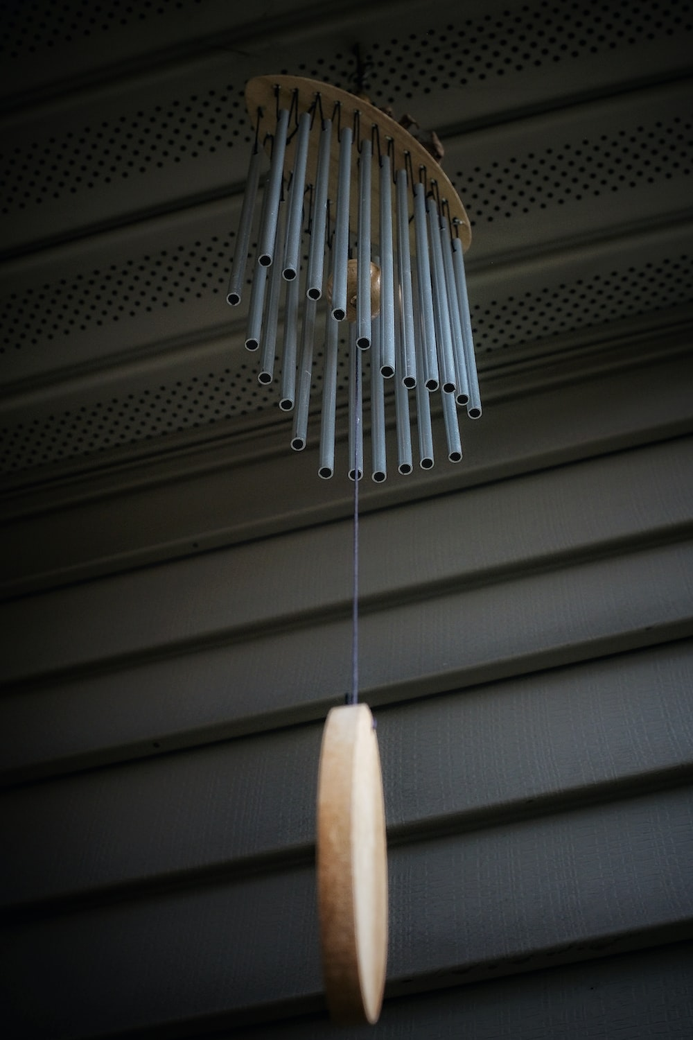 white and silver wind chime