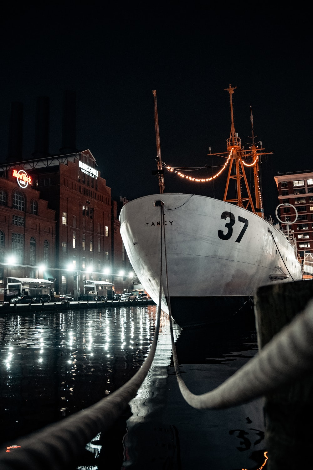 white and red ship on dock during night time
