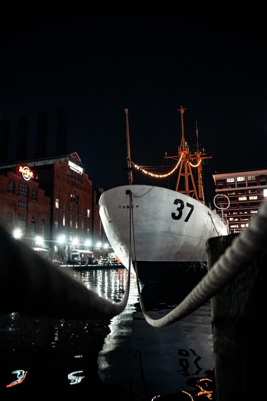 white ship on dock during night time