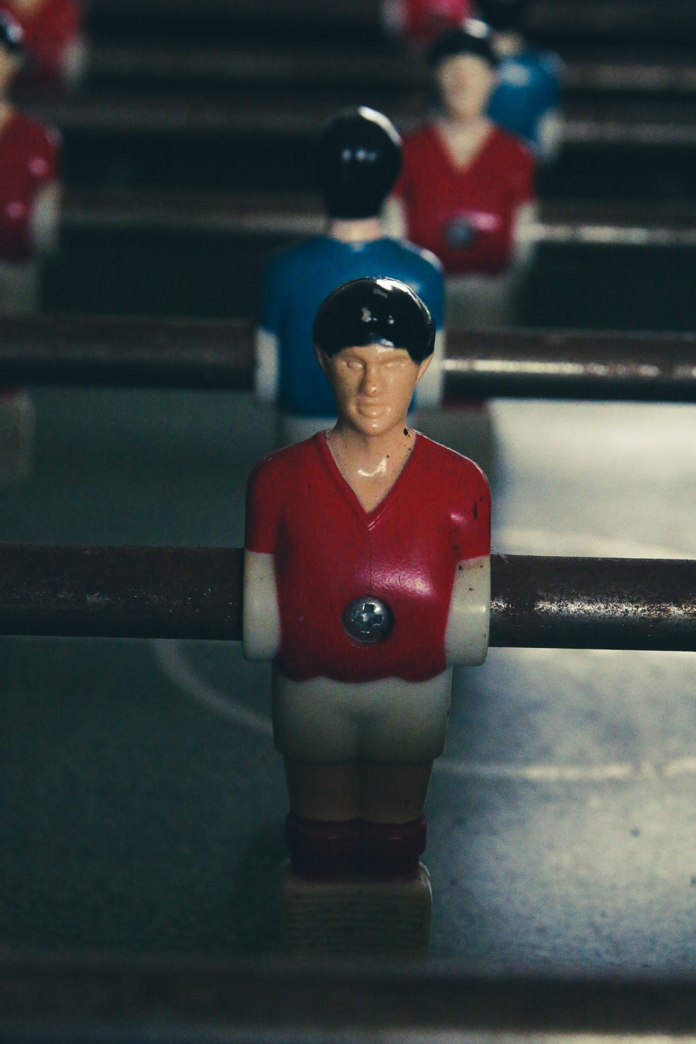 man in red and blue jersey shirt and blue cap figurine