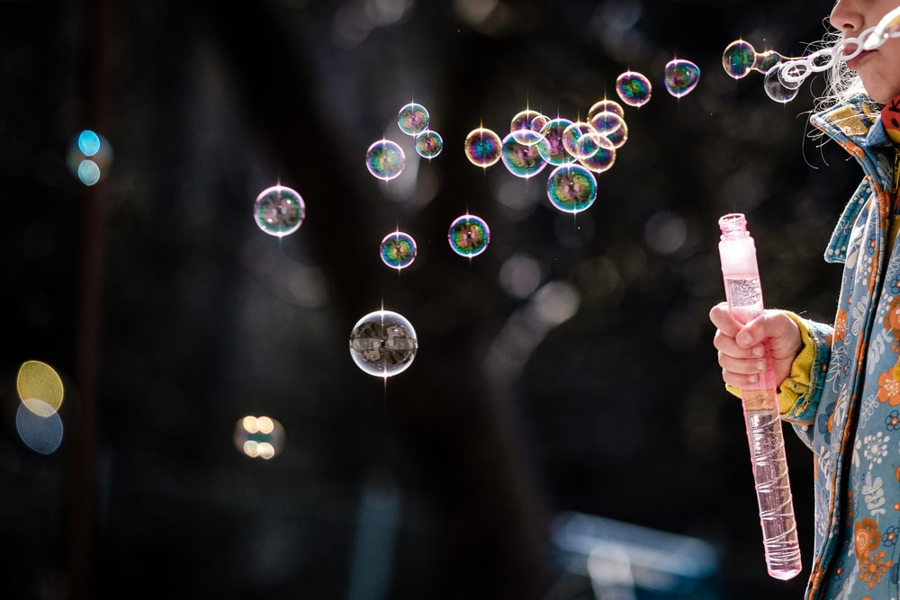 person holding bubbles during daytime