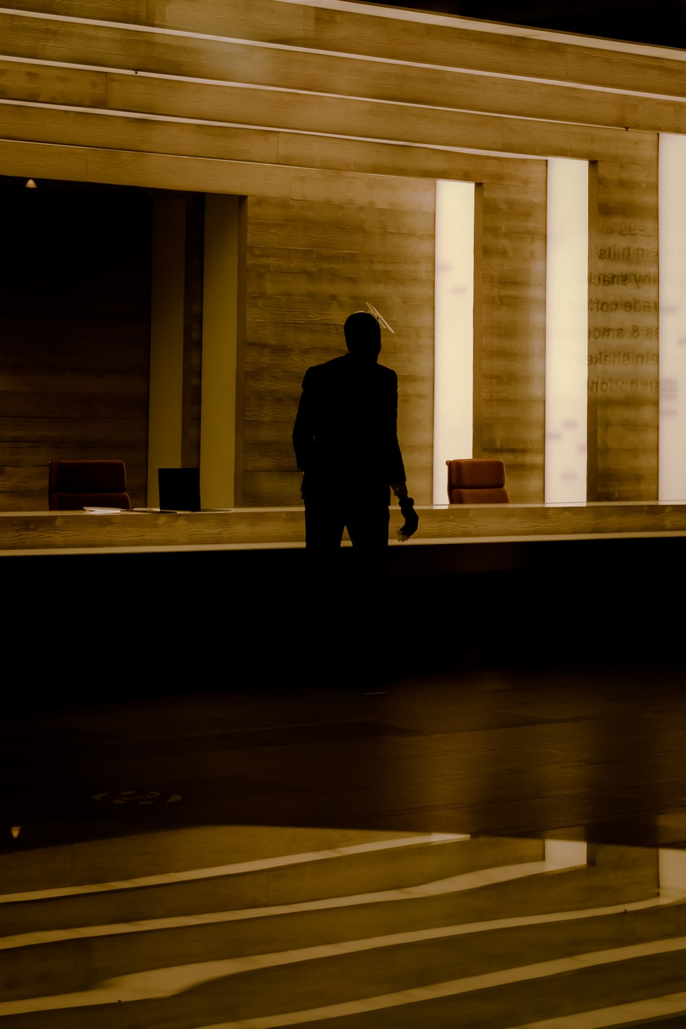 silhouette of person standing on hallway
