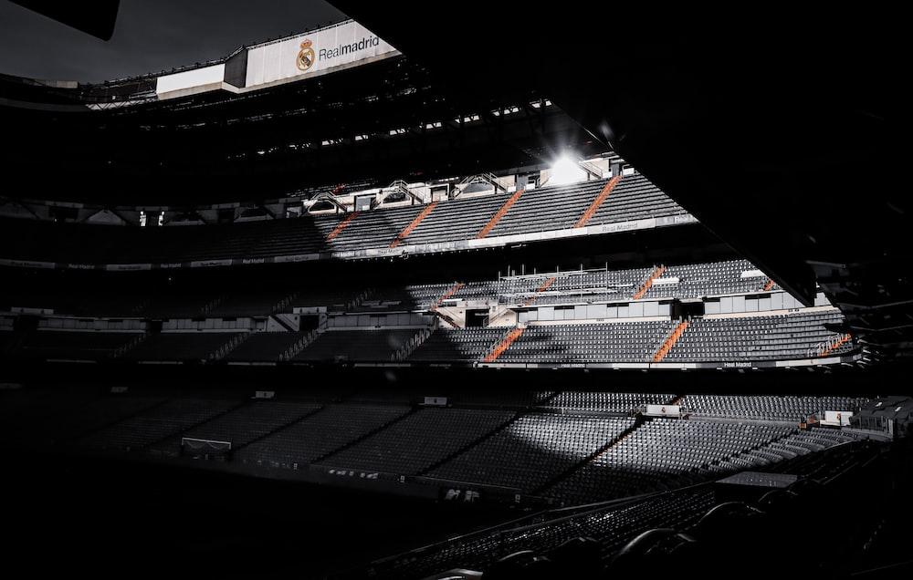 black and white stadium during night time