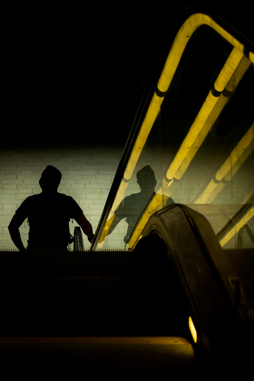 silhouette of man sitting on stairs