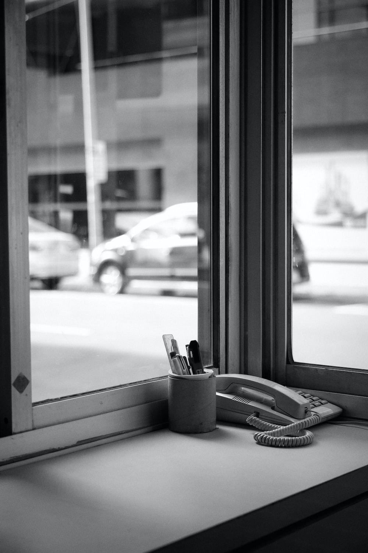 white telephone beside white telephone on white table