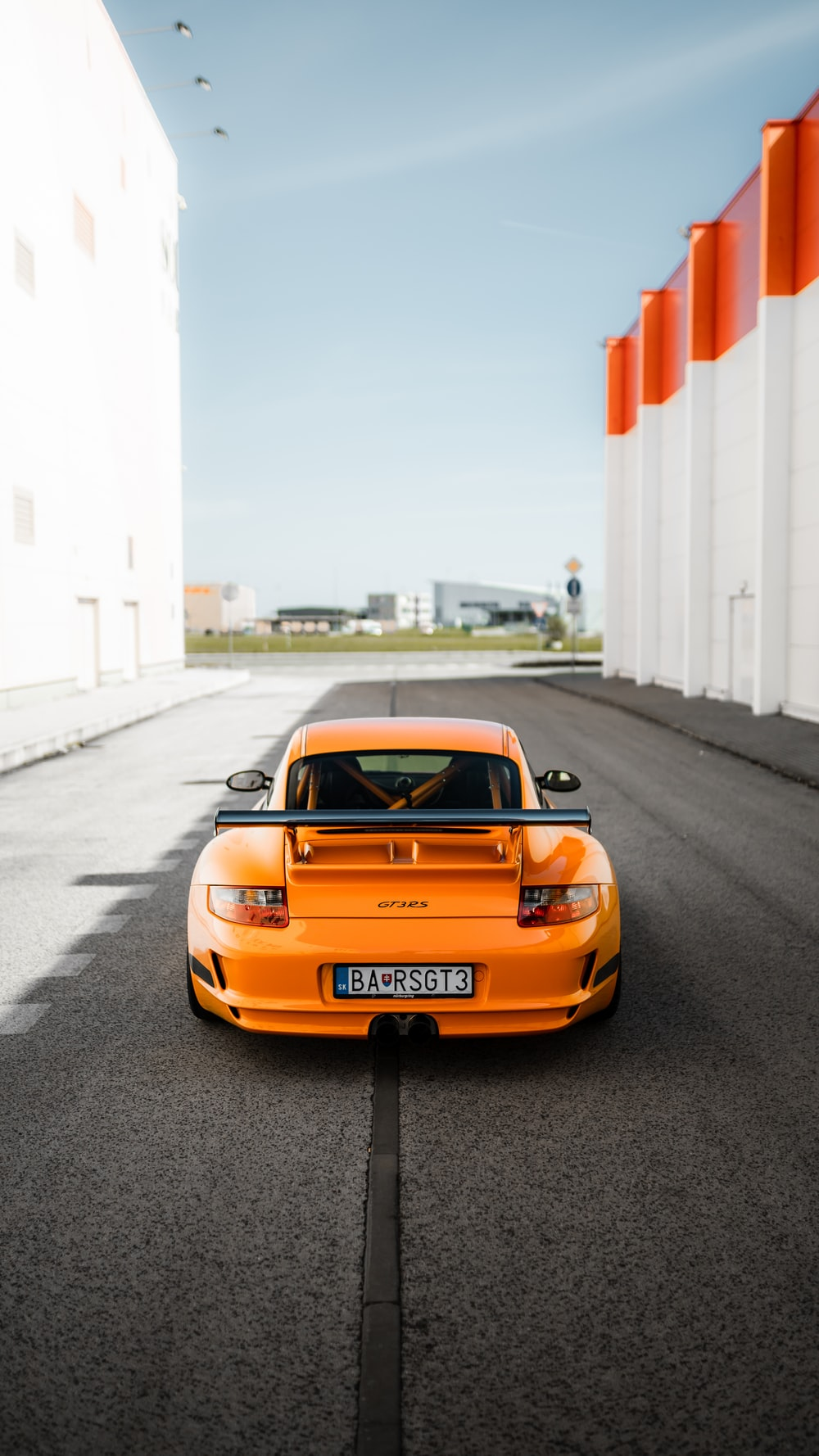 orange porsche 911 on road during daytime