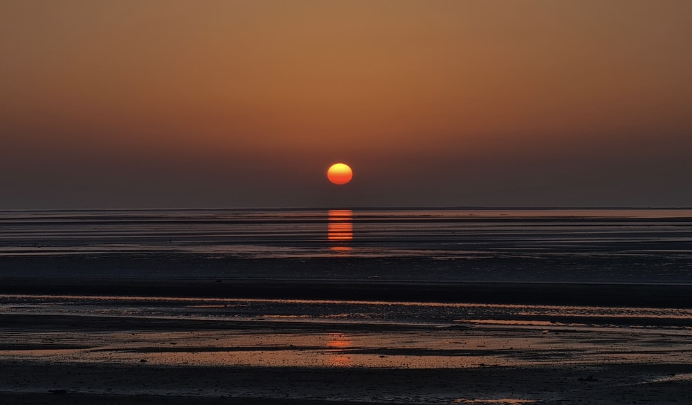 sunset over the sea with beach