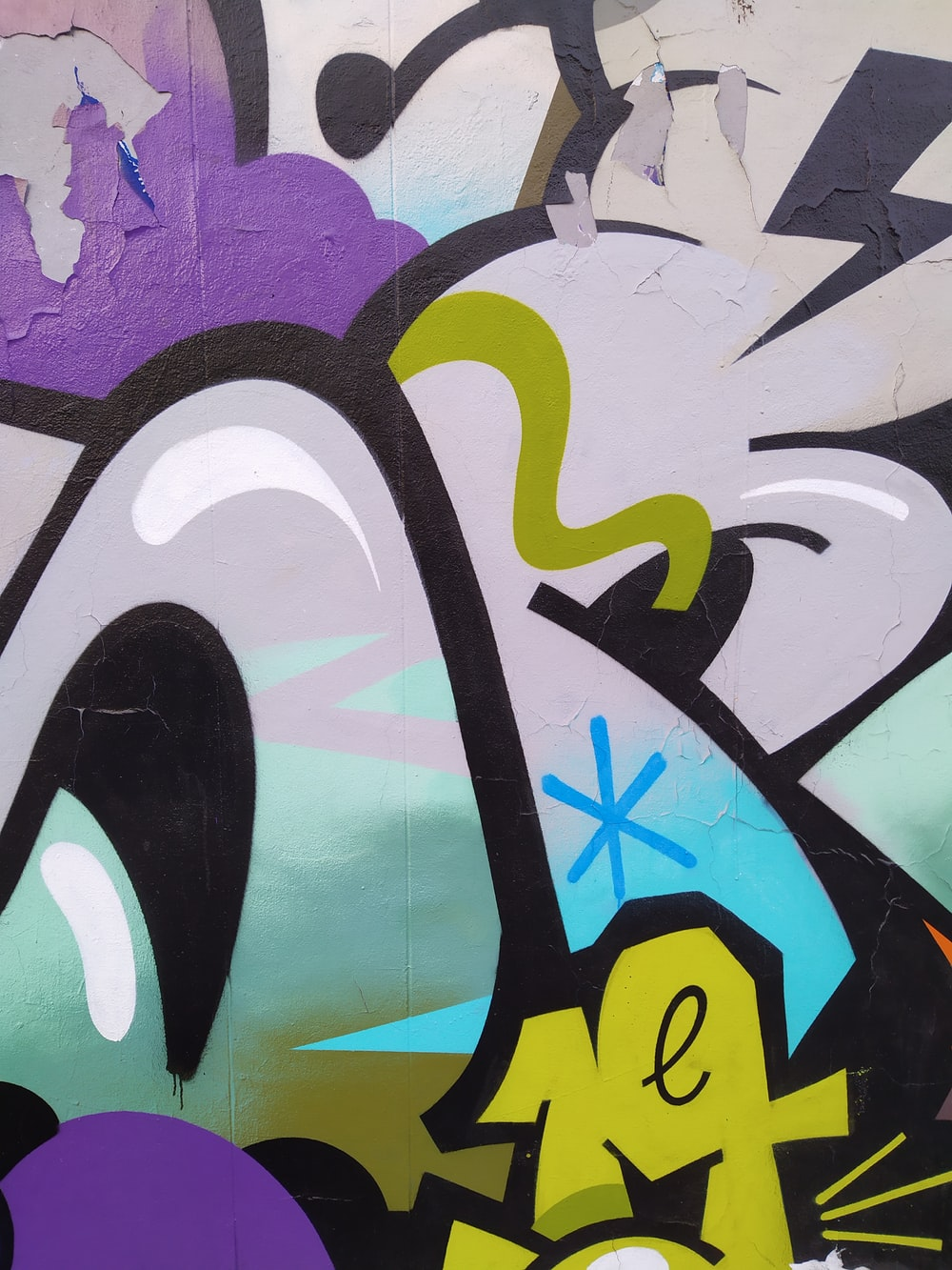 black and yellow bird graffiti