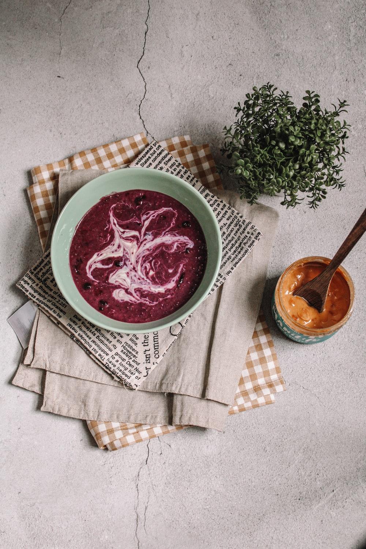 red soup in white ceramic bowl